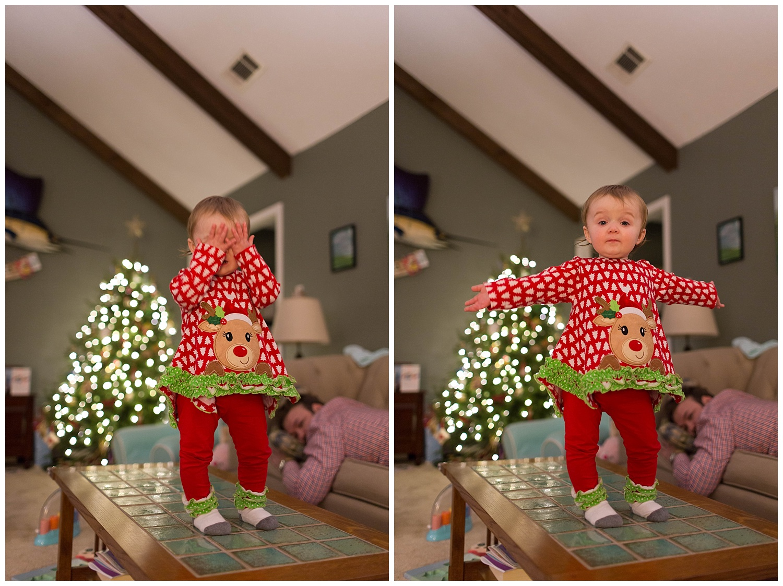 toddler girl playing peekaboo at Christmas time