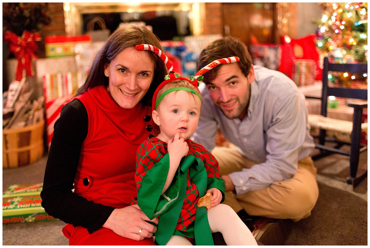 baby girl with mom and uncle at Christmas
