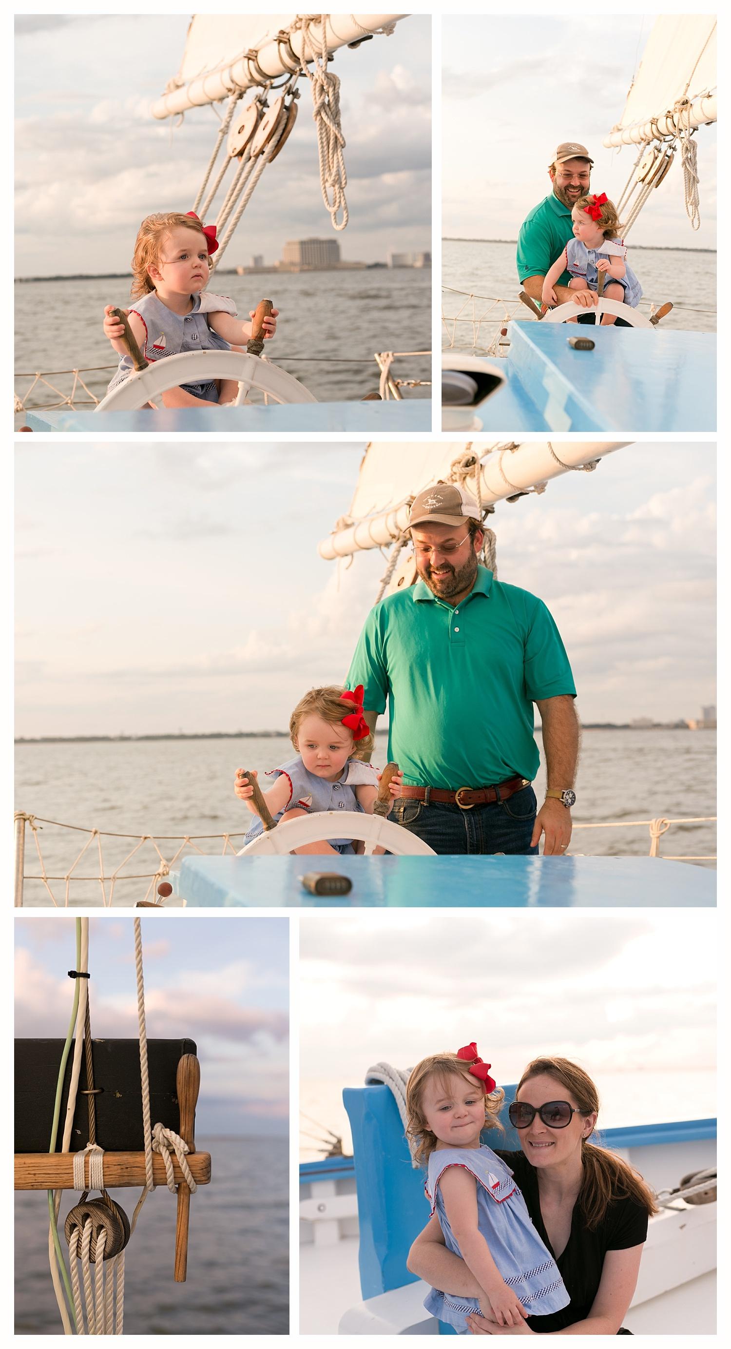 two year old girl steering sailing ship (Biloxi Schooner)