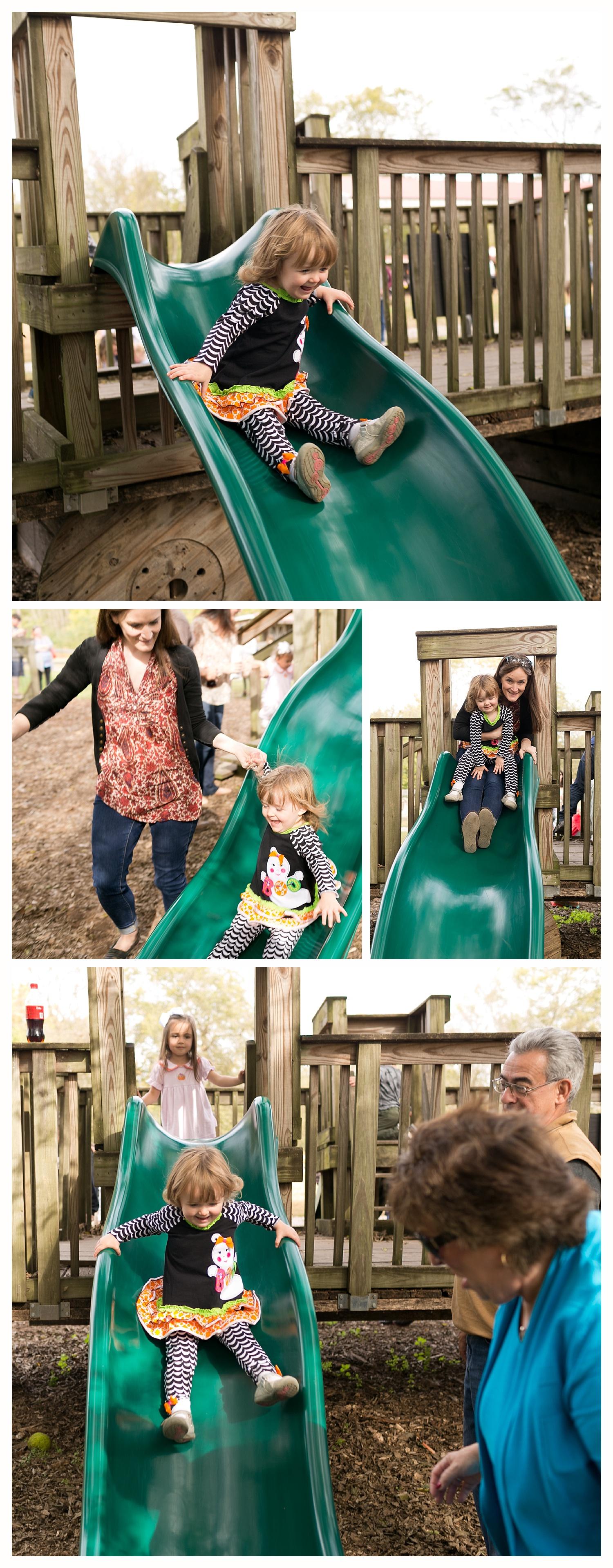 little girl having fun on slide at Gentry's Farm