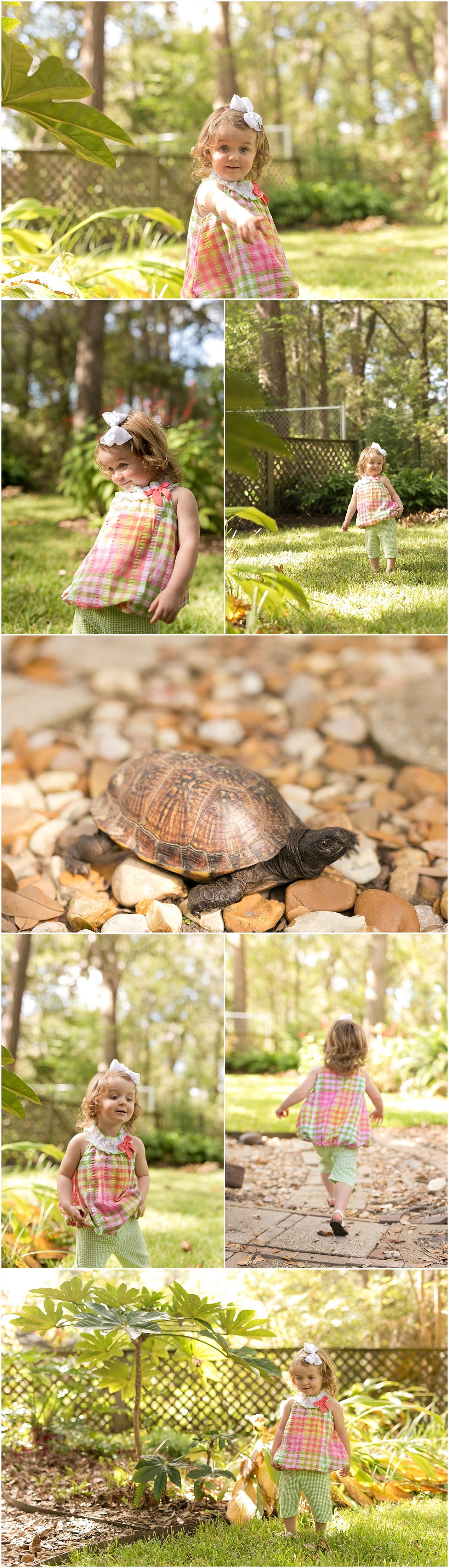 little girl with turtle in backyard