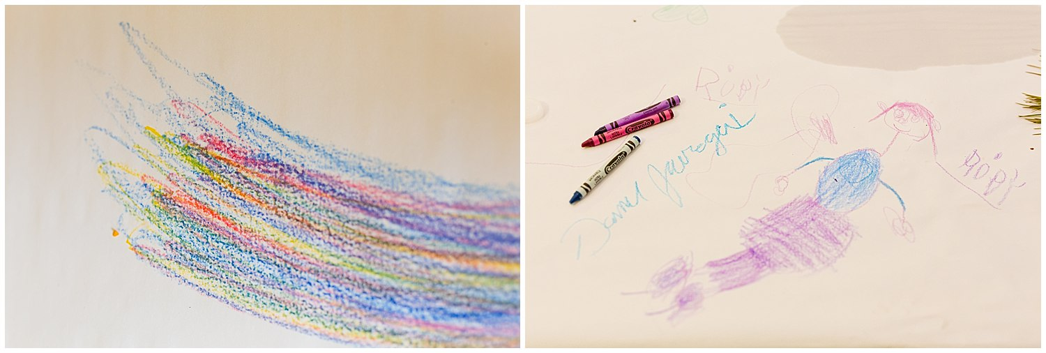 kids' drawings with crayons on paper tablecloth