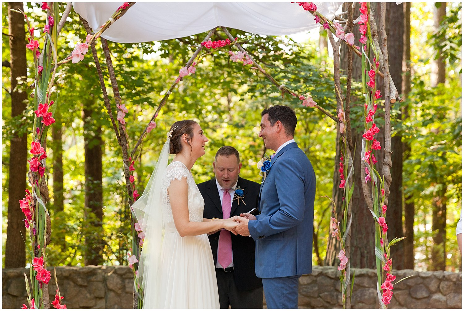 pretty outdoor wedding ceremony with floral chuppah
