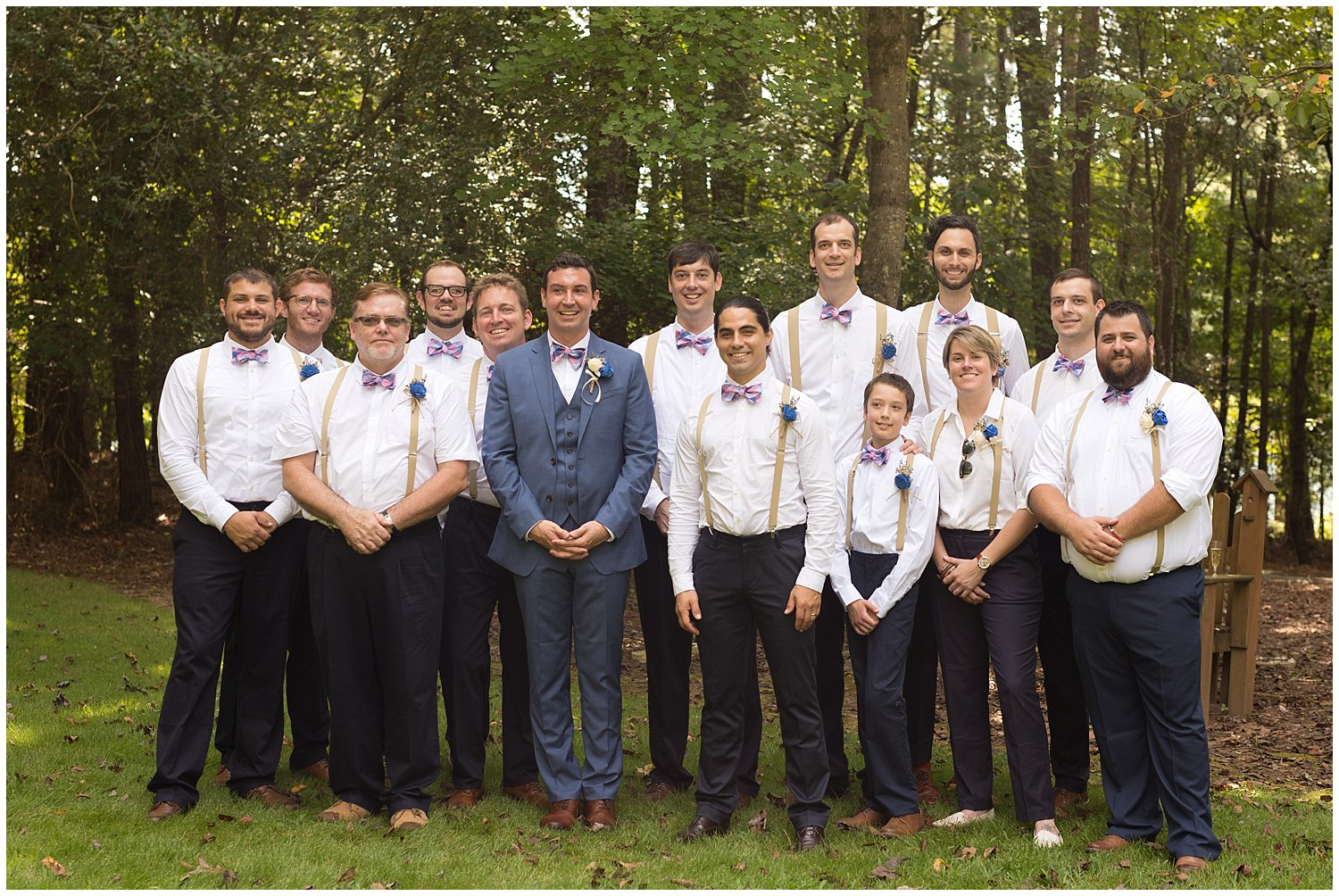 large group of groomsmen with bowties and suspenders