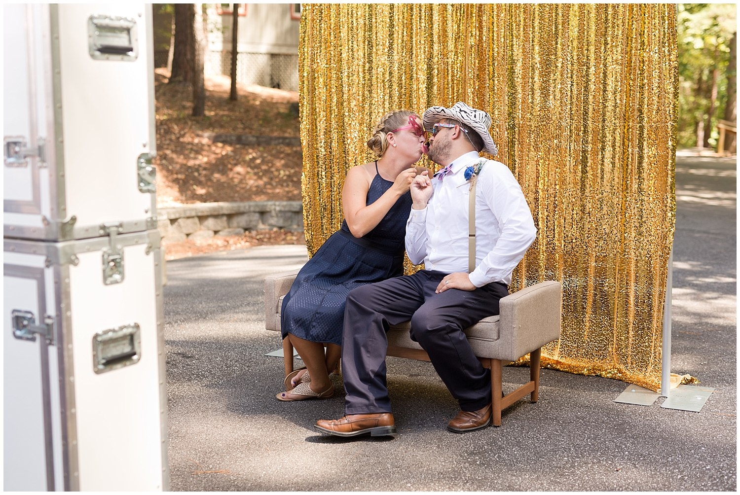 couple being funny in wedding photo booth