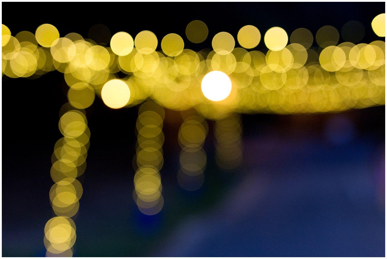 twinkle lights on dance floor at camp wedding - destination wedding photographer