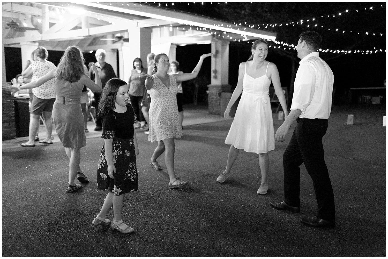 bride and groom on dance floor at casual outdoor wedding reception