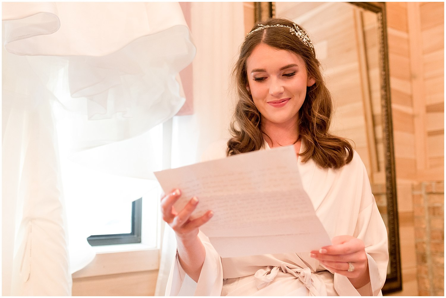 bride reading love letter from groom before wedding - Ocean Springs wedding photographer
