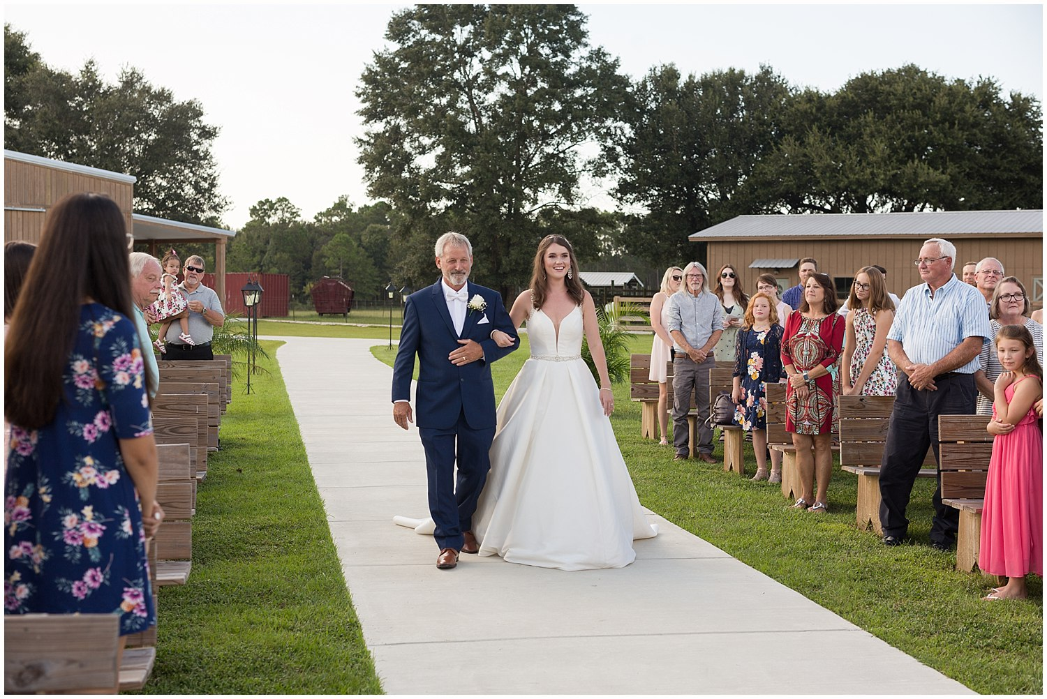 father walking daughter down aisle in Kiln, MS