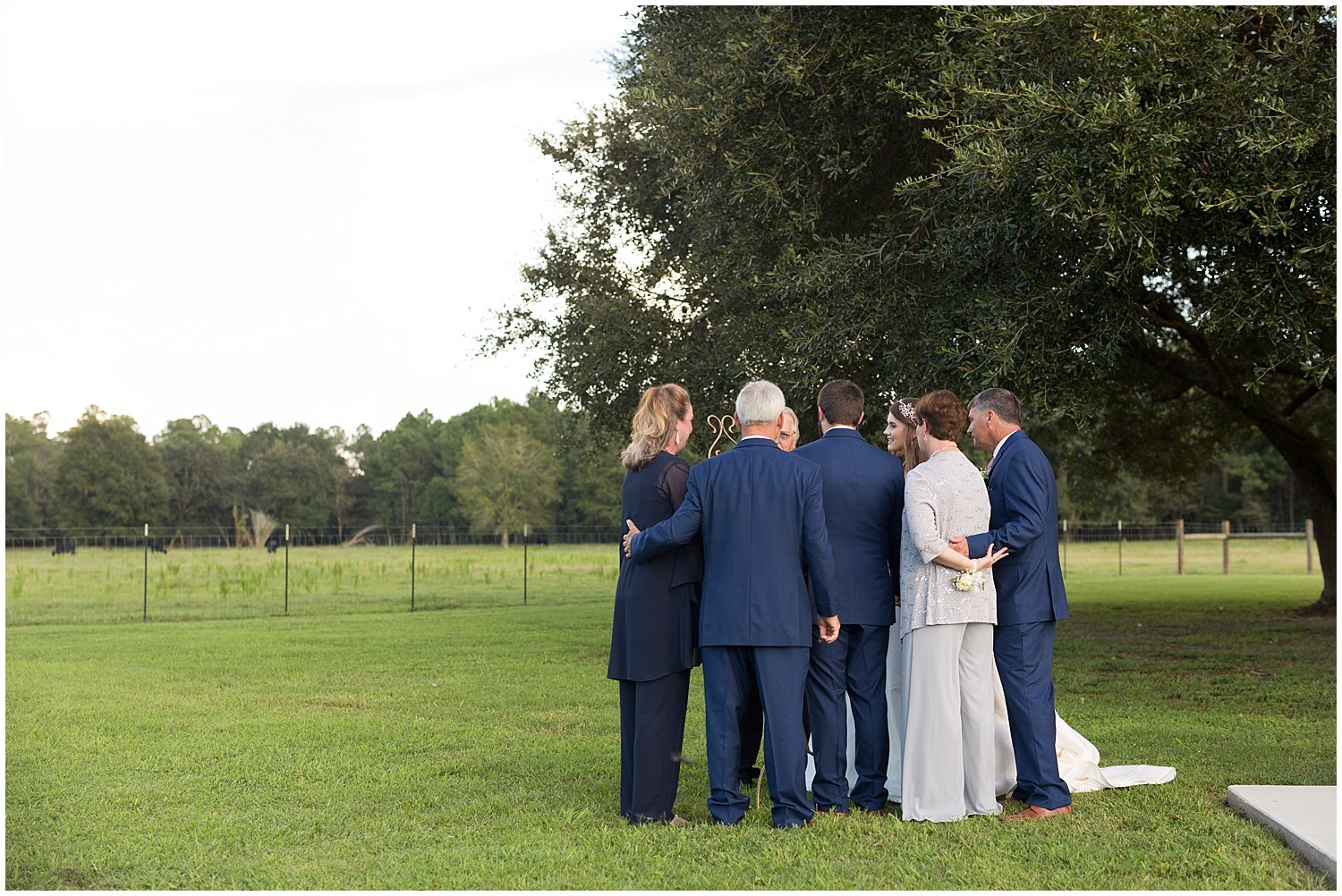 family praying at wedding ceremony