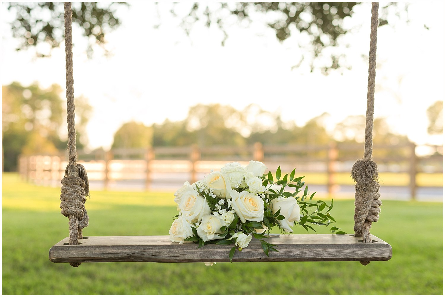 wedding bouquet on swing at barn venue