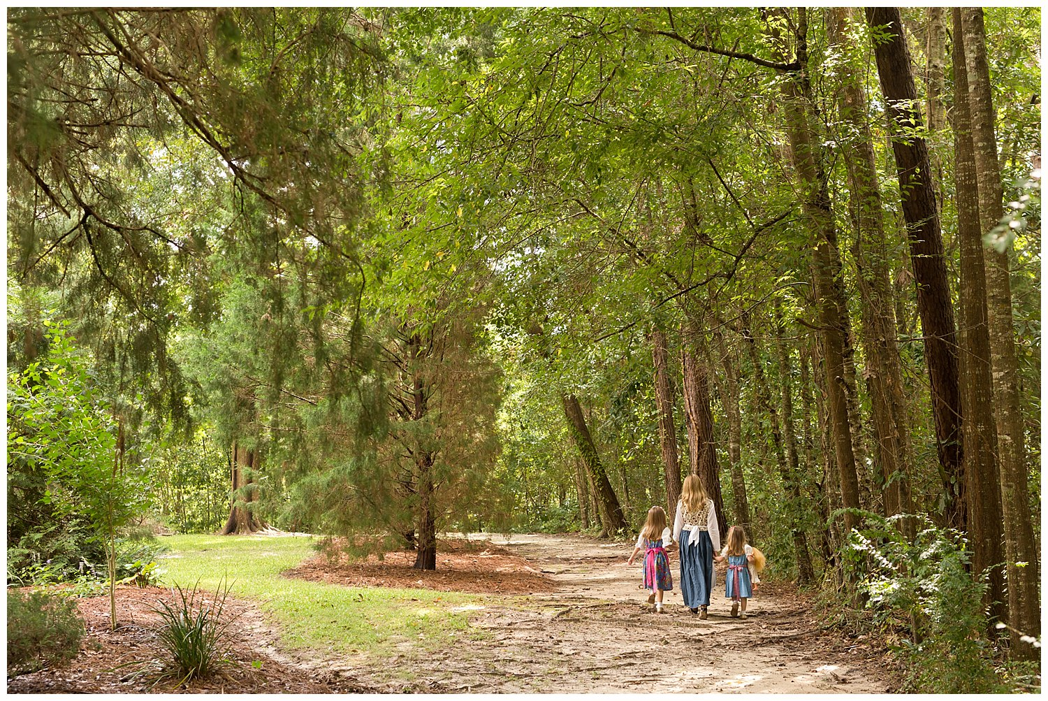 candid photo of girls in the woods in Ocean Springs, Mississippi