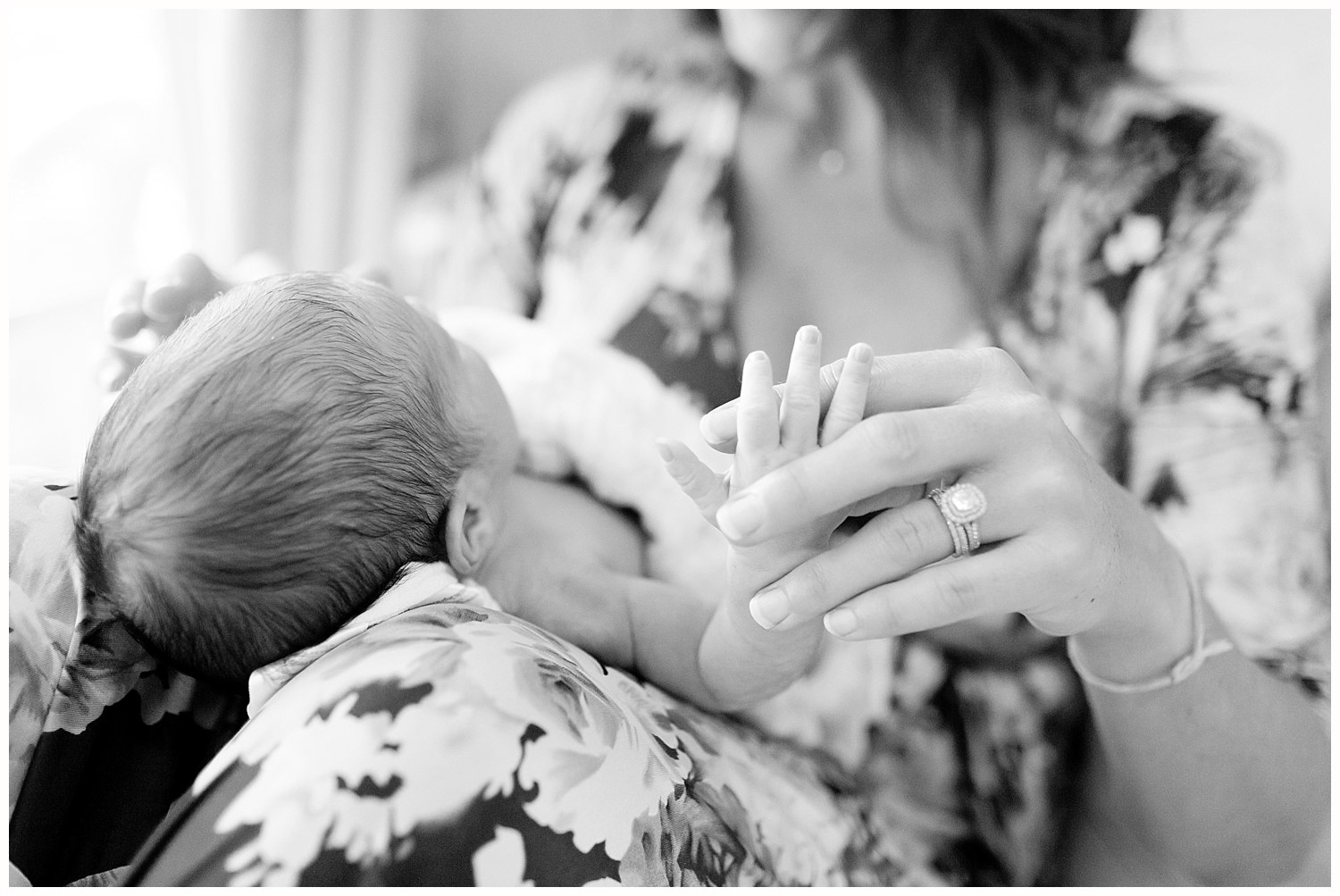 black and white picture of mom holding baby - Ocean Springs baby photographer