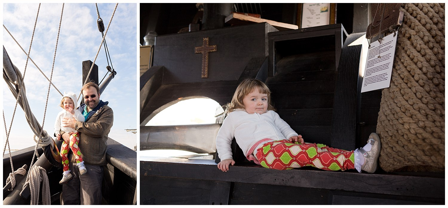 daddy and daughter on old ship replica