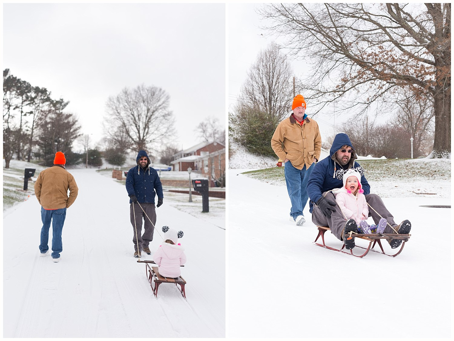 little girl sledding with dad and grandfather