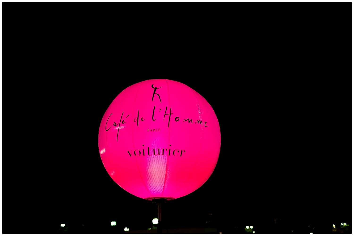 hot pink sign for Café de l'Homme in Paris, France - glowing restaurant sign at night