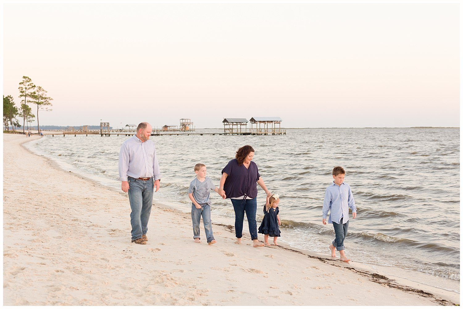 candid family photo - walking on the beach