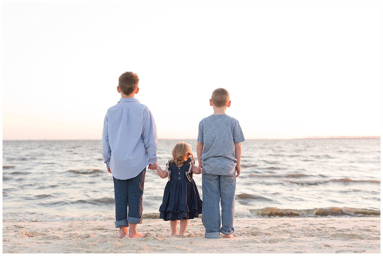 siblings looking at ocean