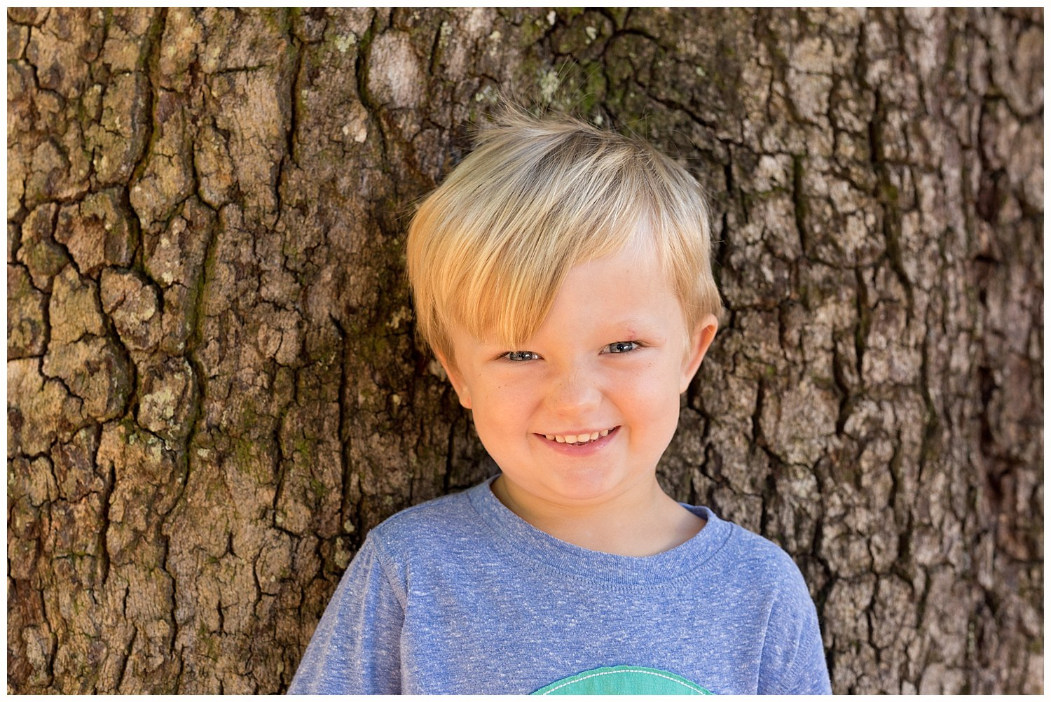 cute little boy with live oak tree bark background
