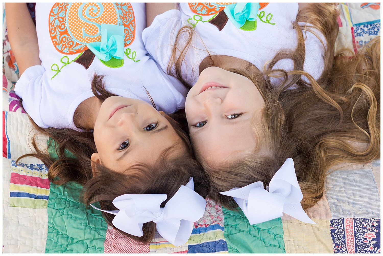 Ocean Springs family photographer - twin girls portrait on vintage quilt