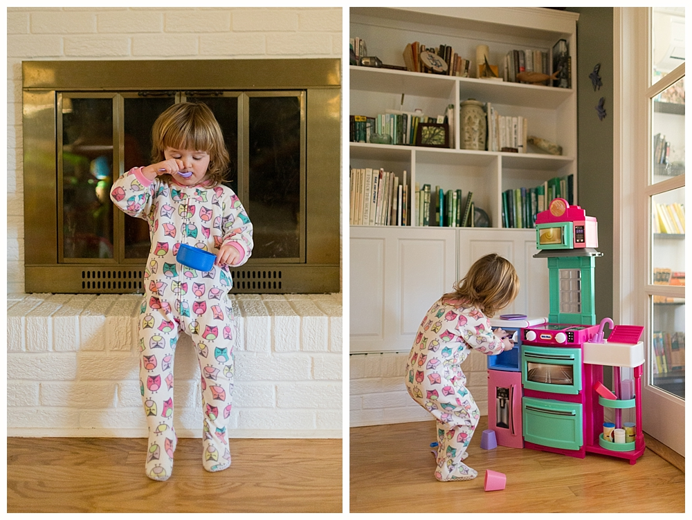 toddler girl playing with toy kitchen