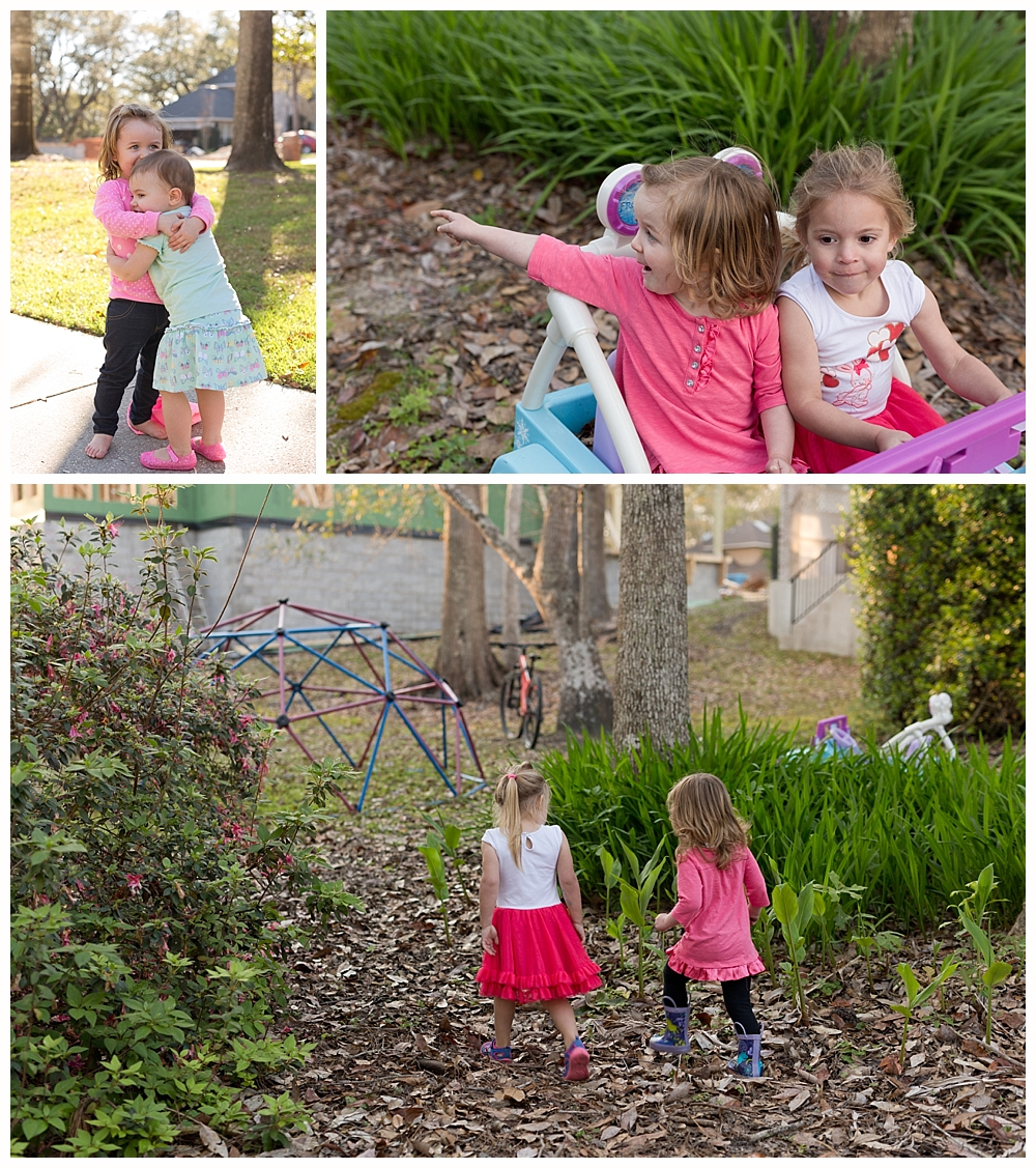 little girls playing together outside in neighborhood