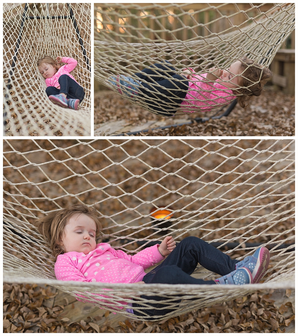 two-year-old girl napping in hammock on back deck at home