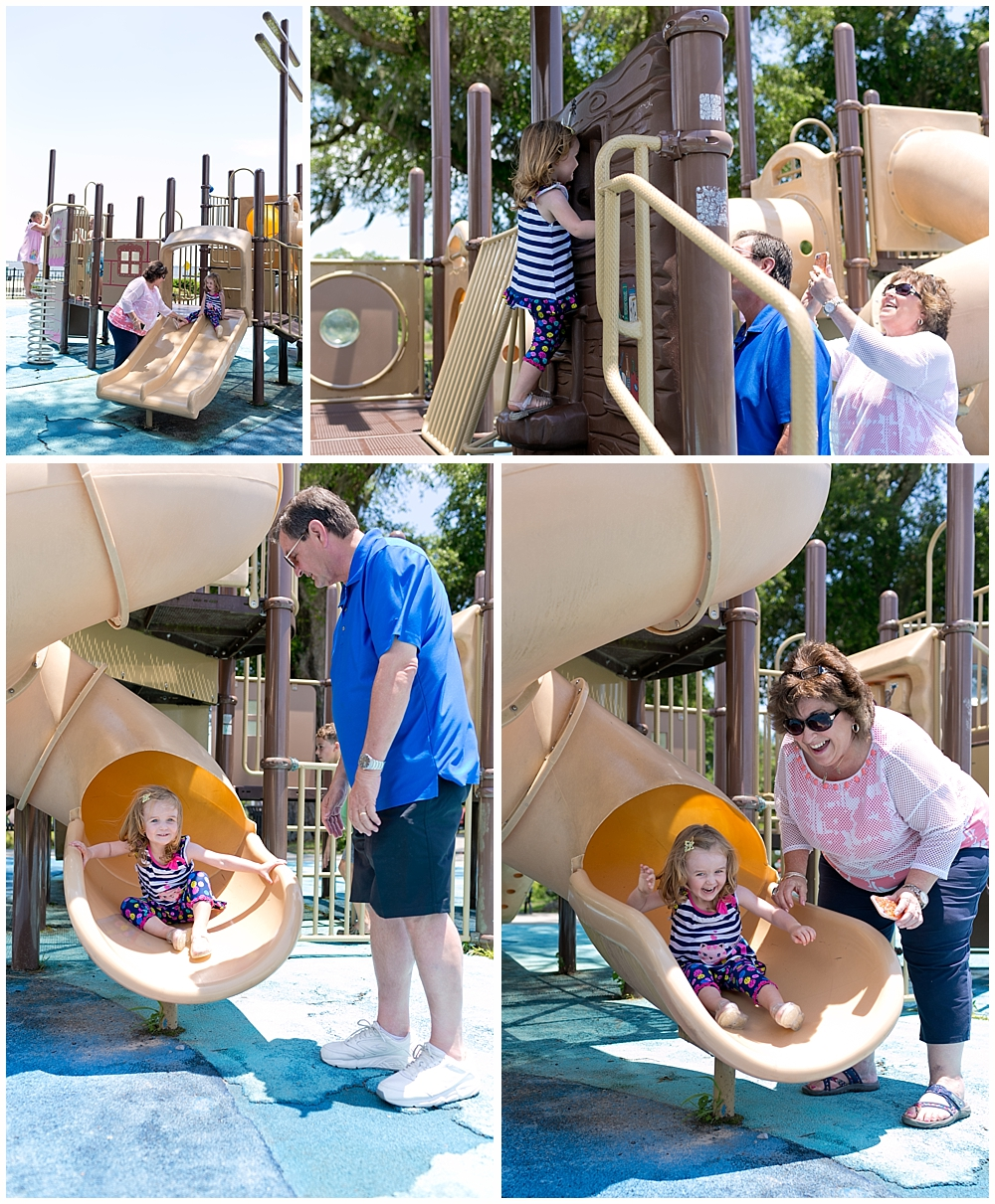 little girl playing with grandparents at Fort Maurepas park playground in Ocean Springs