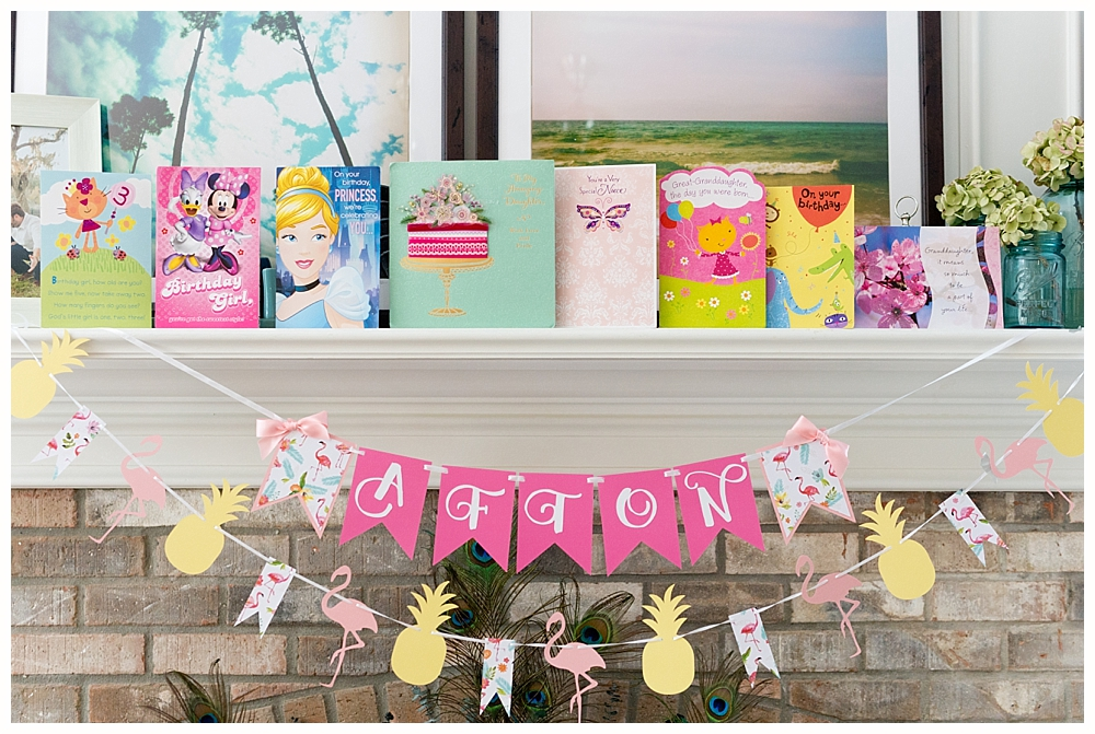 handmade birthday banner with flamingoes and pineapples