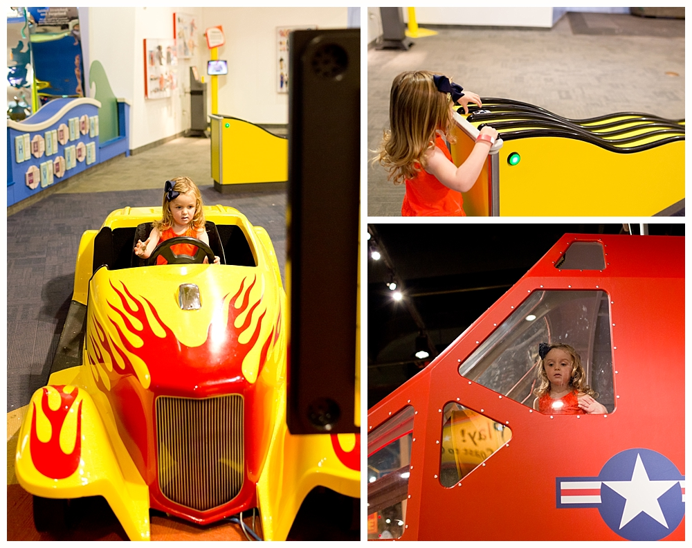 little girl playing with cars at Strong National Museum of Play