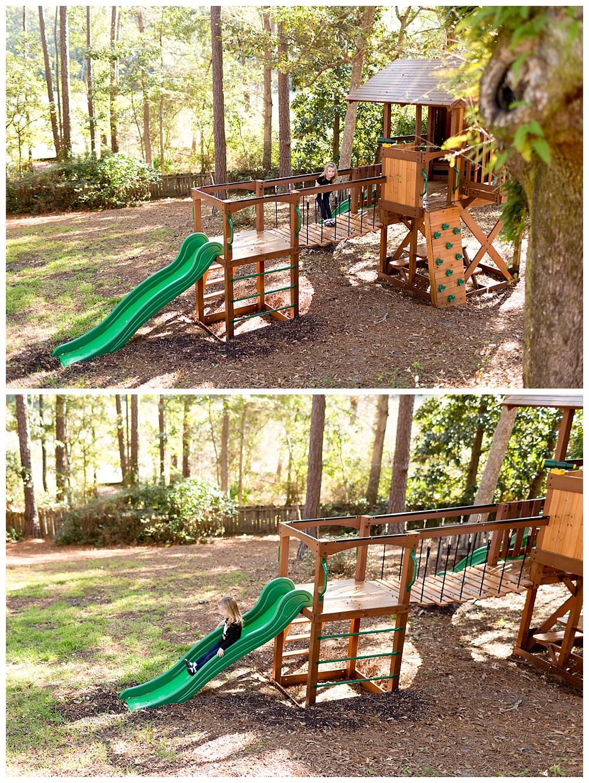 little girl playing on backyard play set