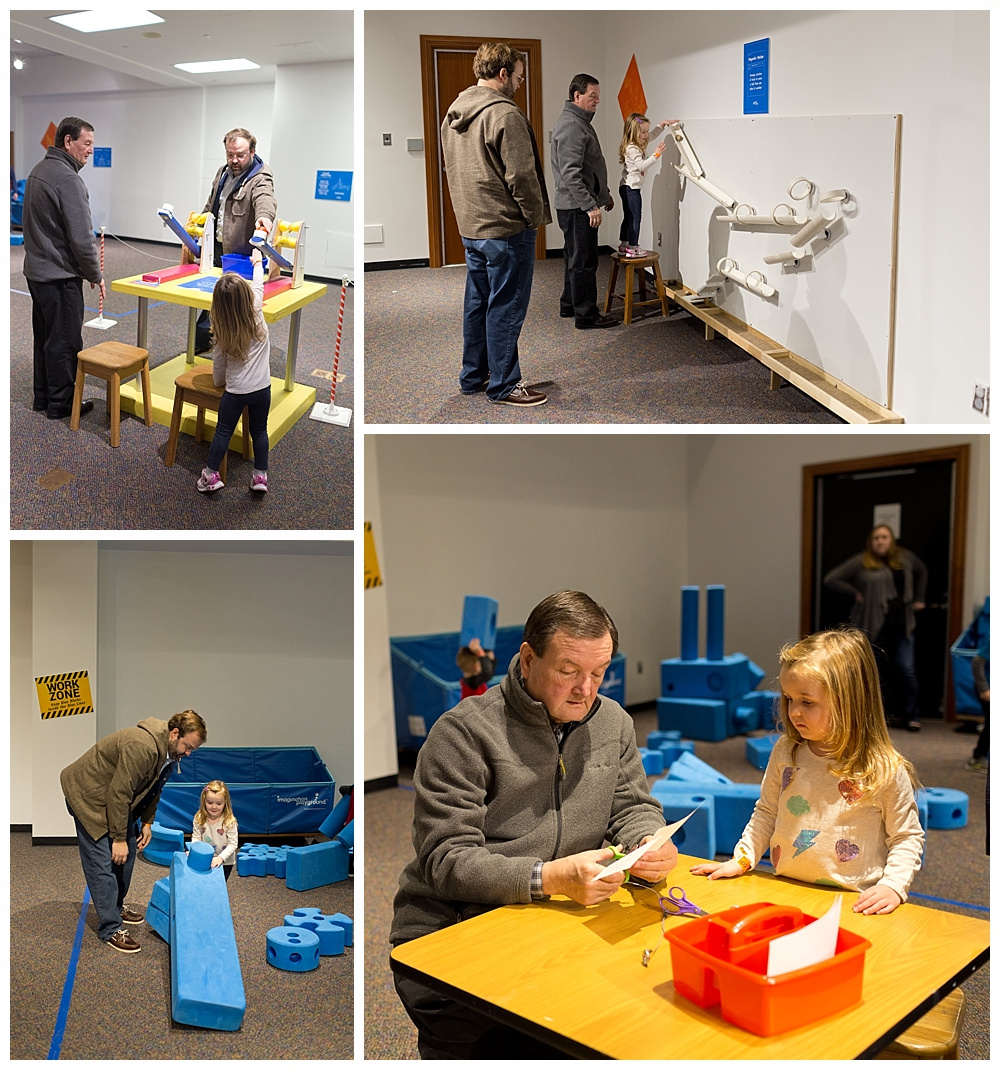 little girl with dad and grandfather at physics exhibit at Clay Center Avampato Discovery Museum