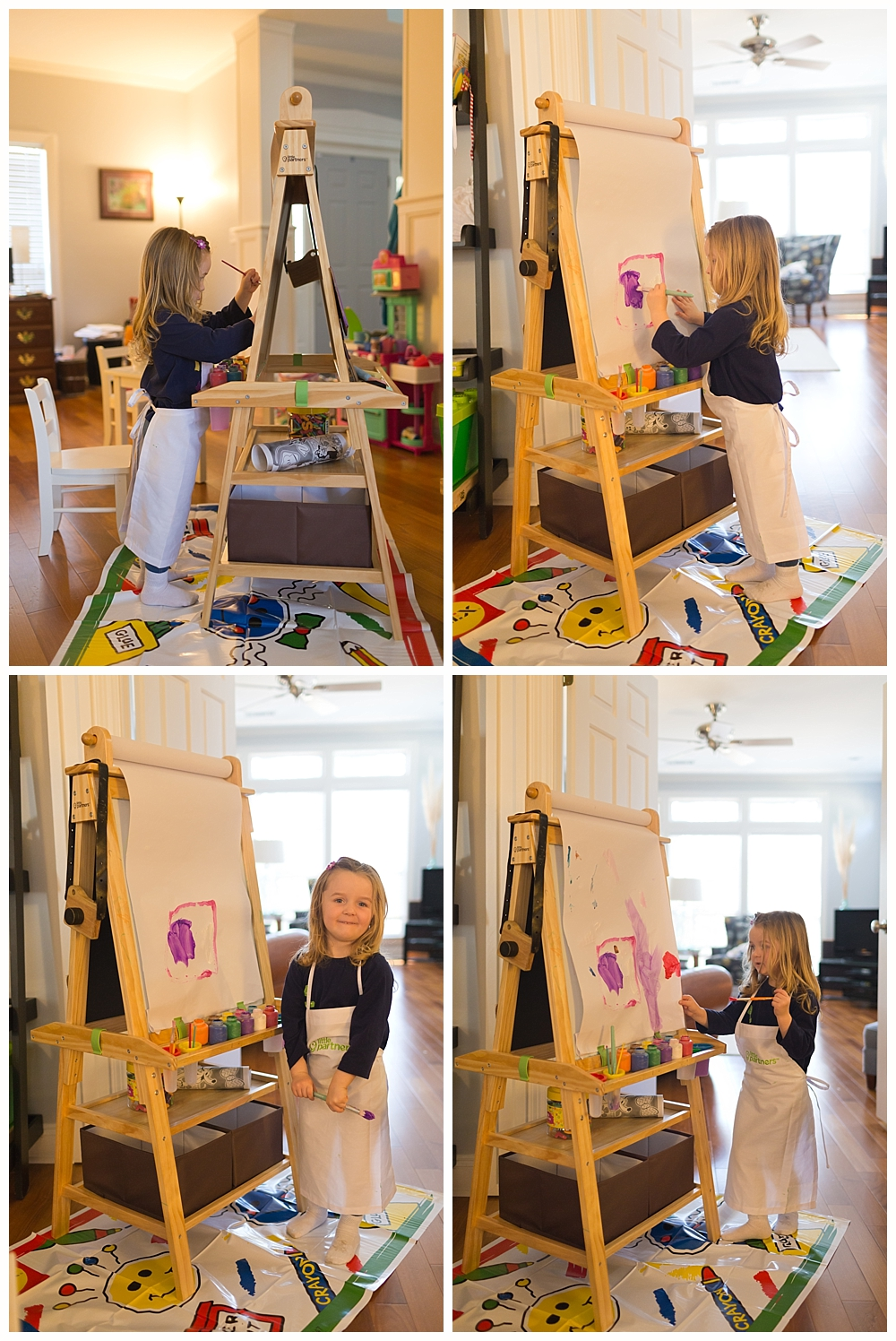 cute little girl painting on easel
