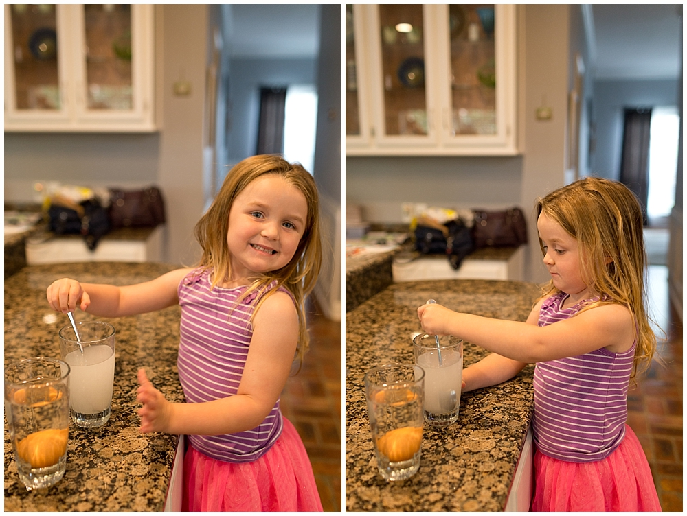 little girl doing sink or float science experiment in the kitchen