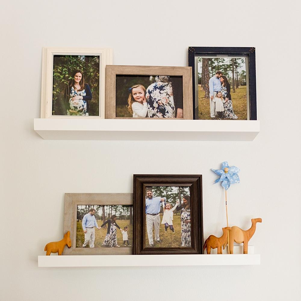 family maternity photos as wall decor in baby's nursery