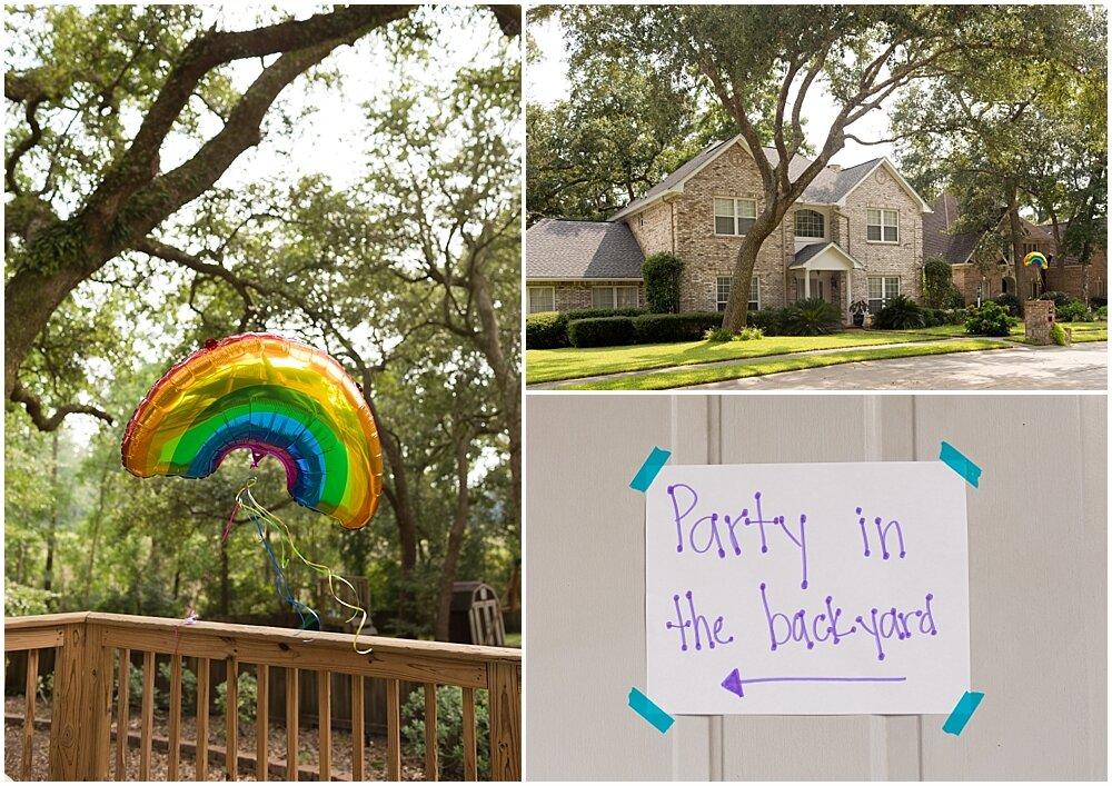 backyard birthday party with rainbow balloons