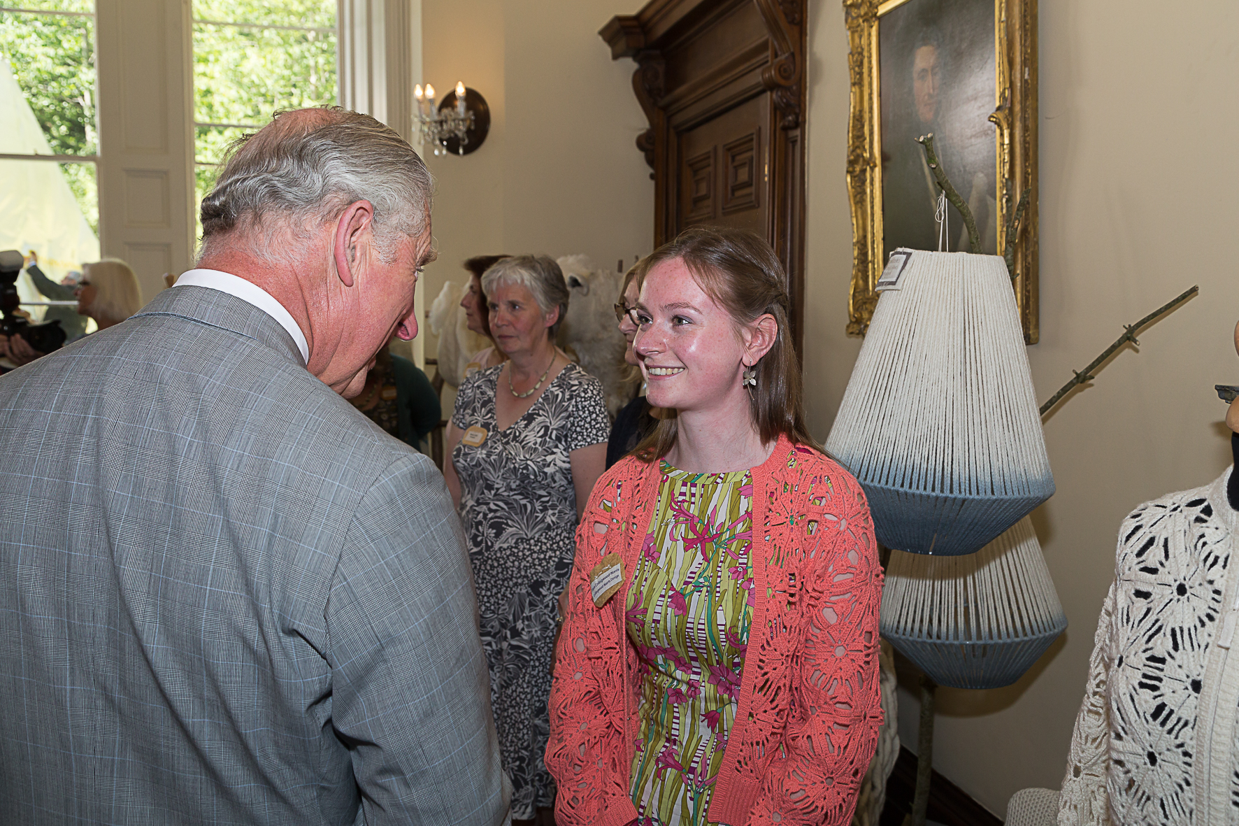 Wearing the new crochet bomber jacket, with HRH Prince charles