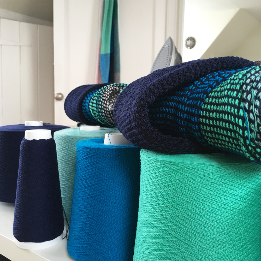 Lots of colourful lambswool, with  Tiree Scarves  just off the knitting machine.