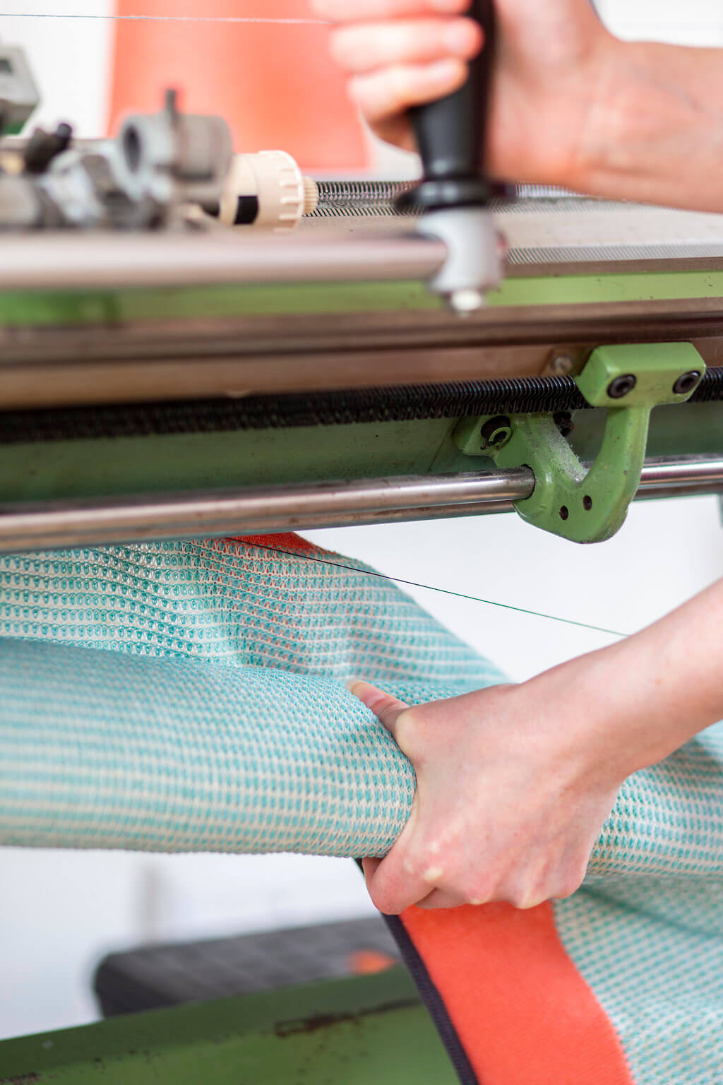 An  Erraid Blanket Scarf  being taken off the knitting machine.