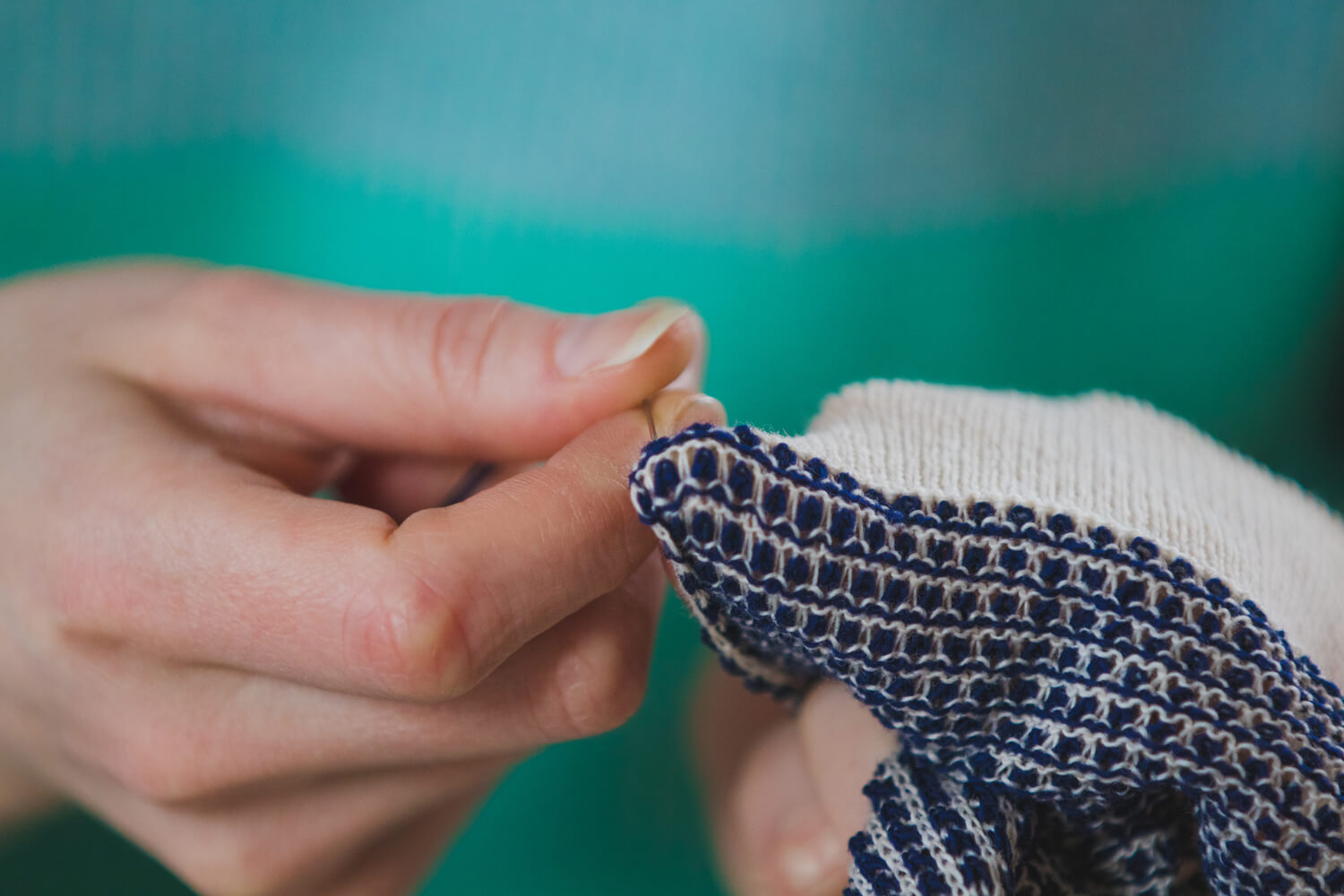 Hand sewing the final details at Collingwood-Norris. Luxury Knitwear Made in Scotland. .jpg