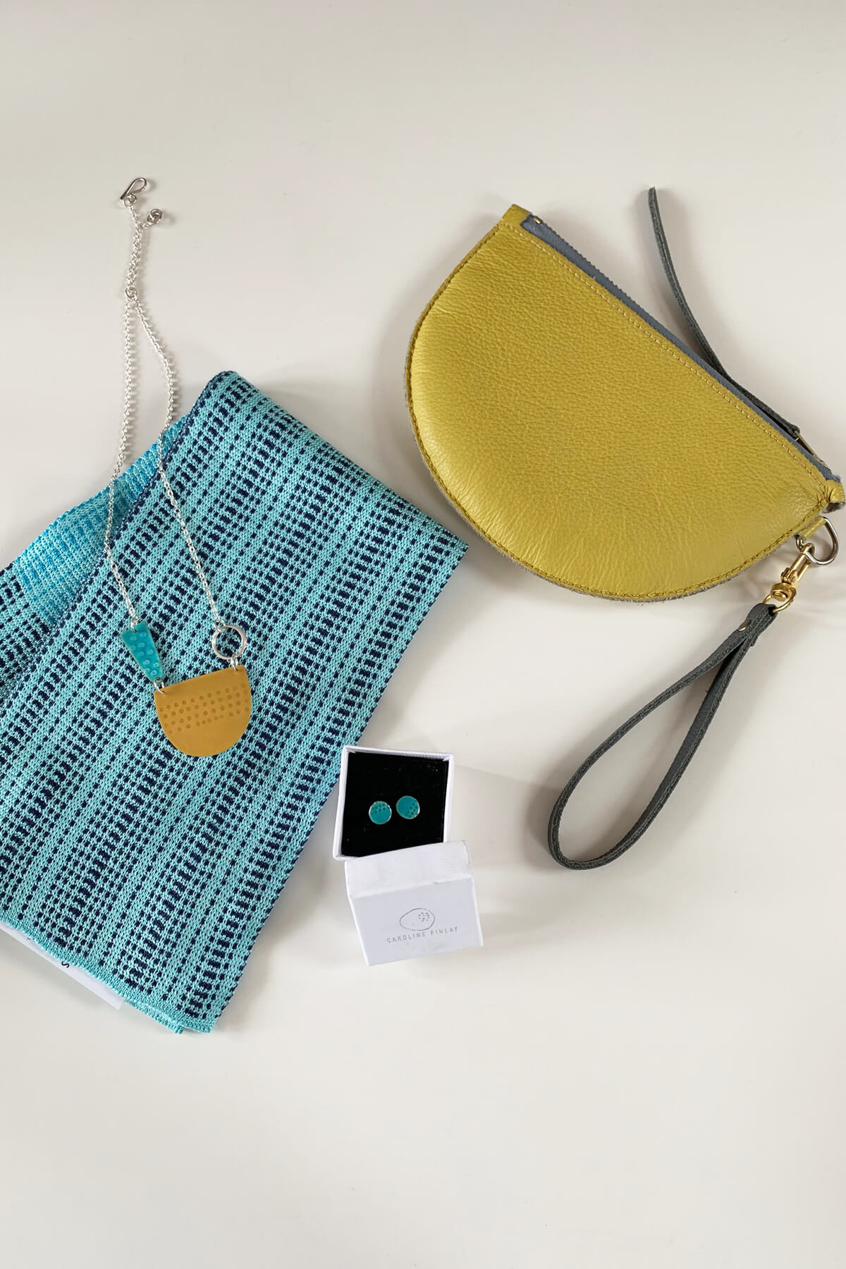 Earrings and necklace by Caroline Finlay. Wristlet purse by Jude Gove