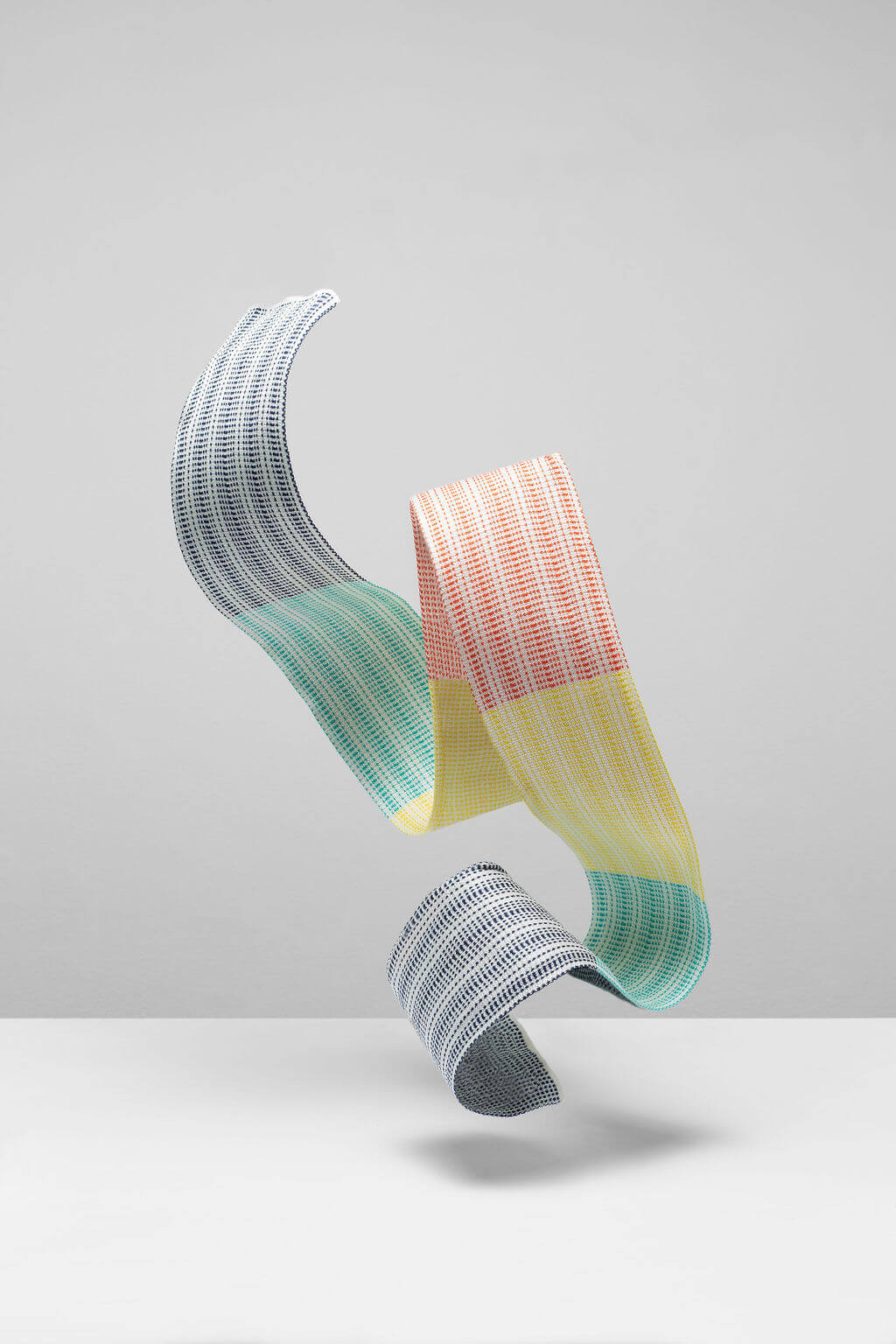 Designer silk scarf for men and women. A skinny silk scarf in pastel colours made in Scotland. Luxury Scottish Knitwear design by Collingwood-Norris.jpg
