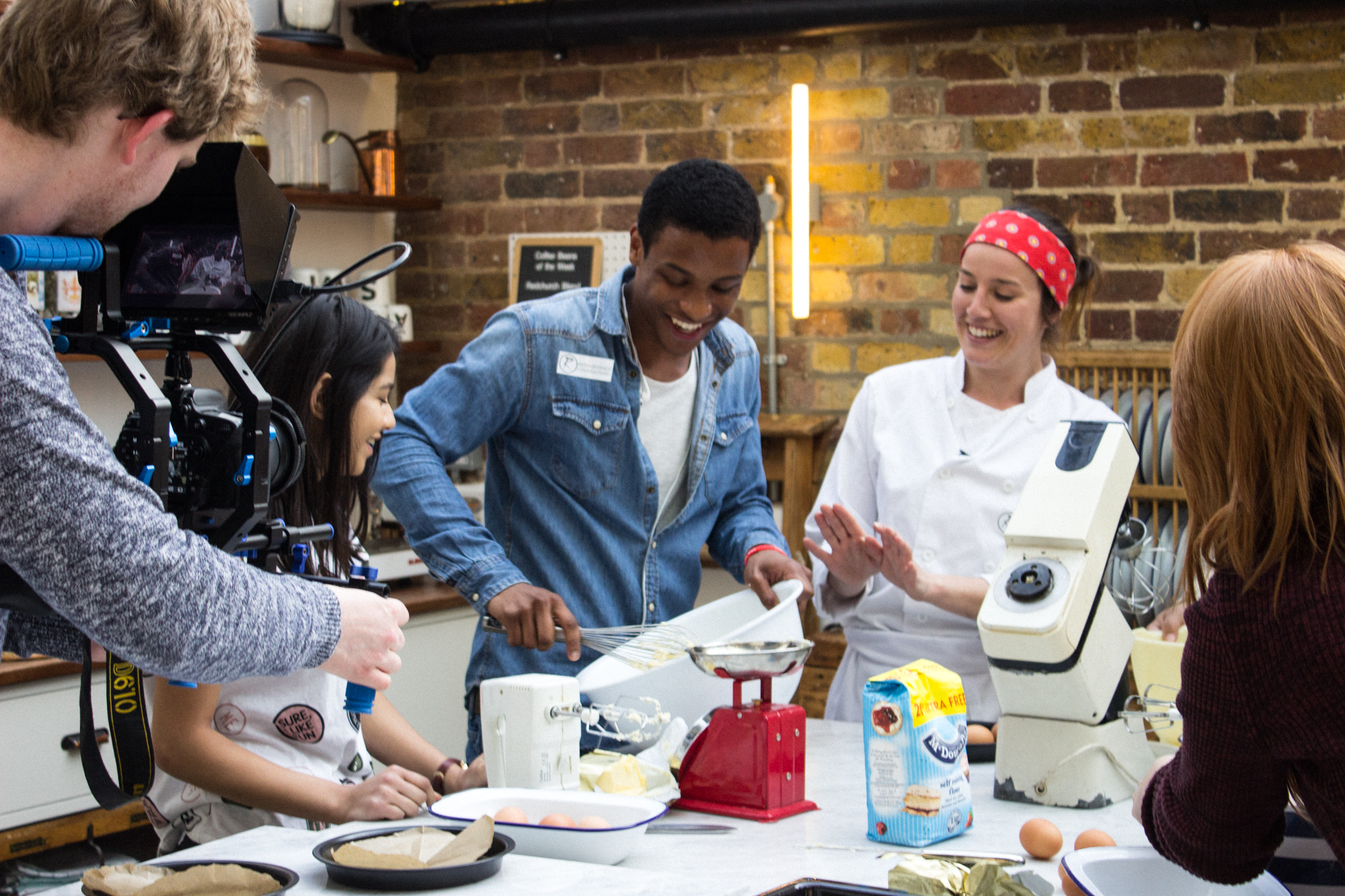 Our Young Leaders at a Cookery session hosted by Clemmie Hadden-Powell at Papermill Studios.