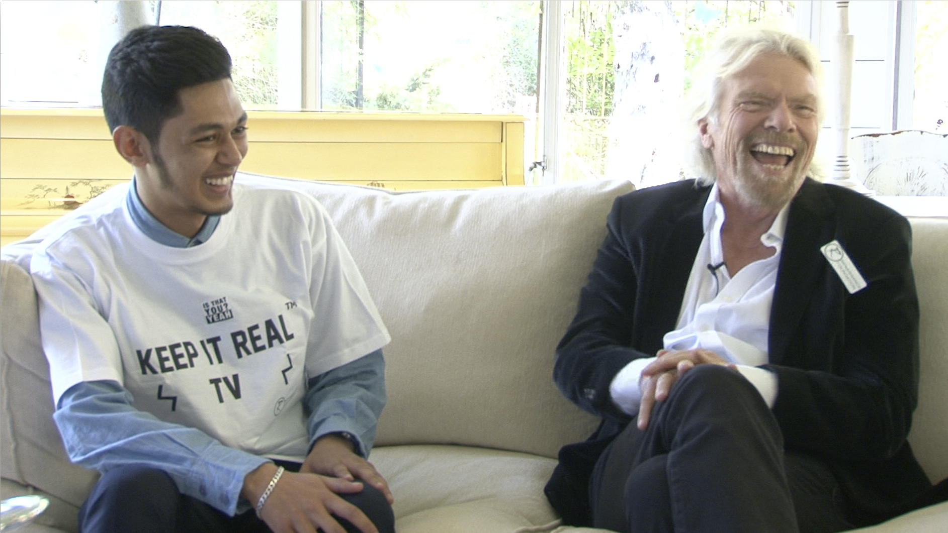 A young leader interviewing Richard Branson