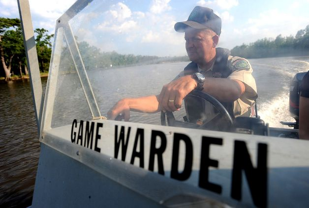 Game Warden Mike Boone patrolling the Neches for Water Safety Violations.jpg