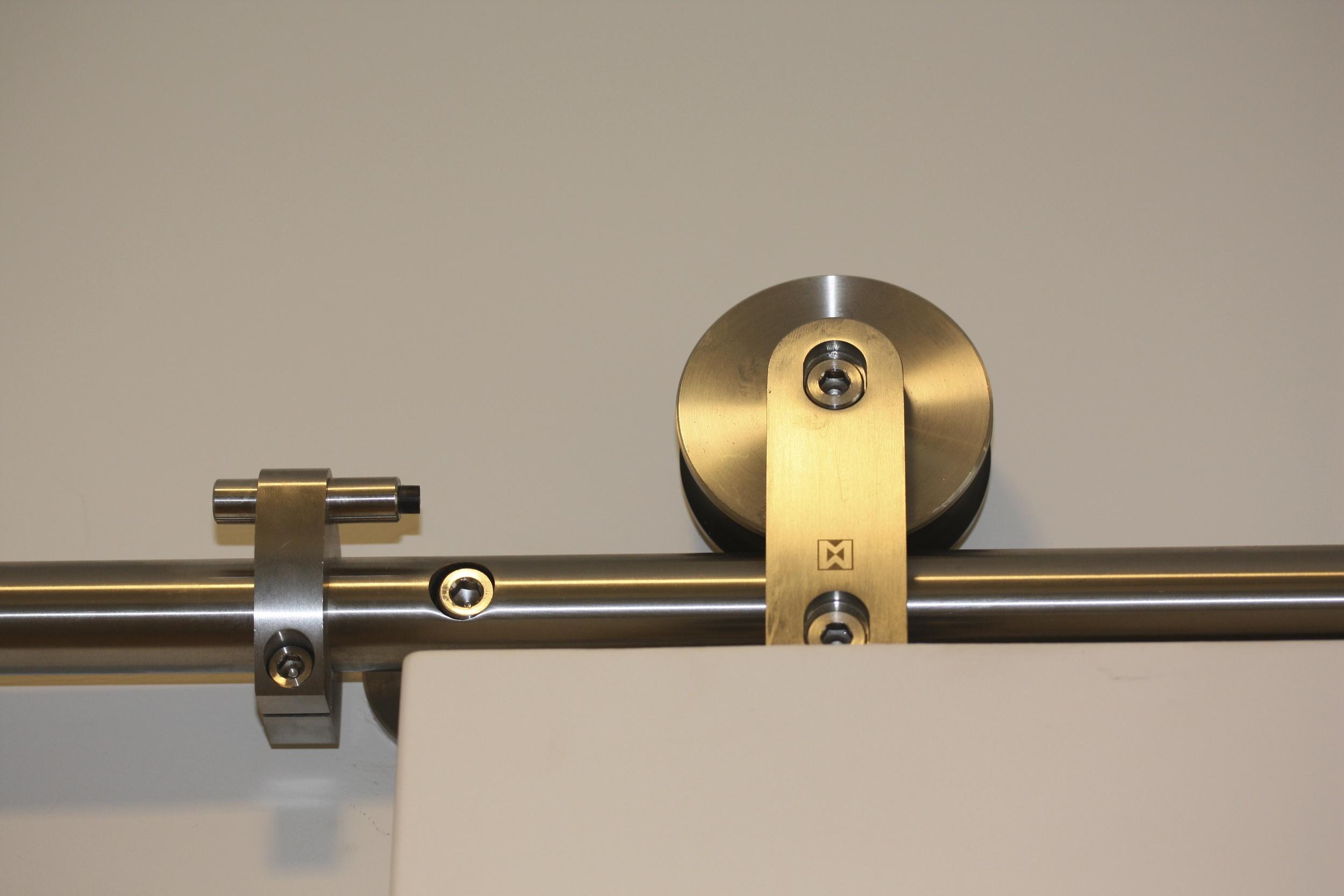 Stainless steel 'barn door' track for sliding bathroom door.