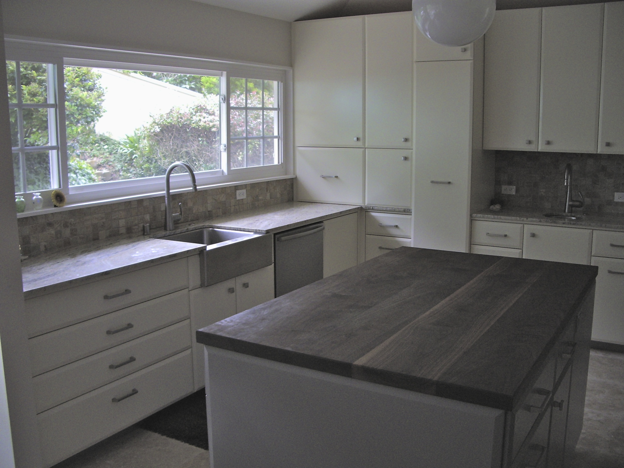 Cabinets feature many pull out drawerswith soft close hardware.