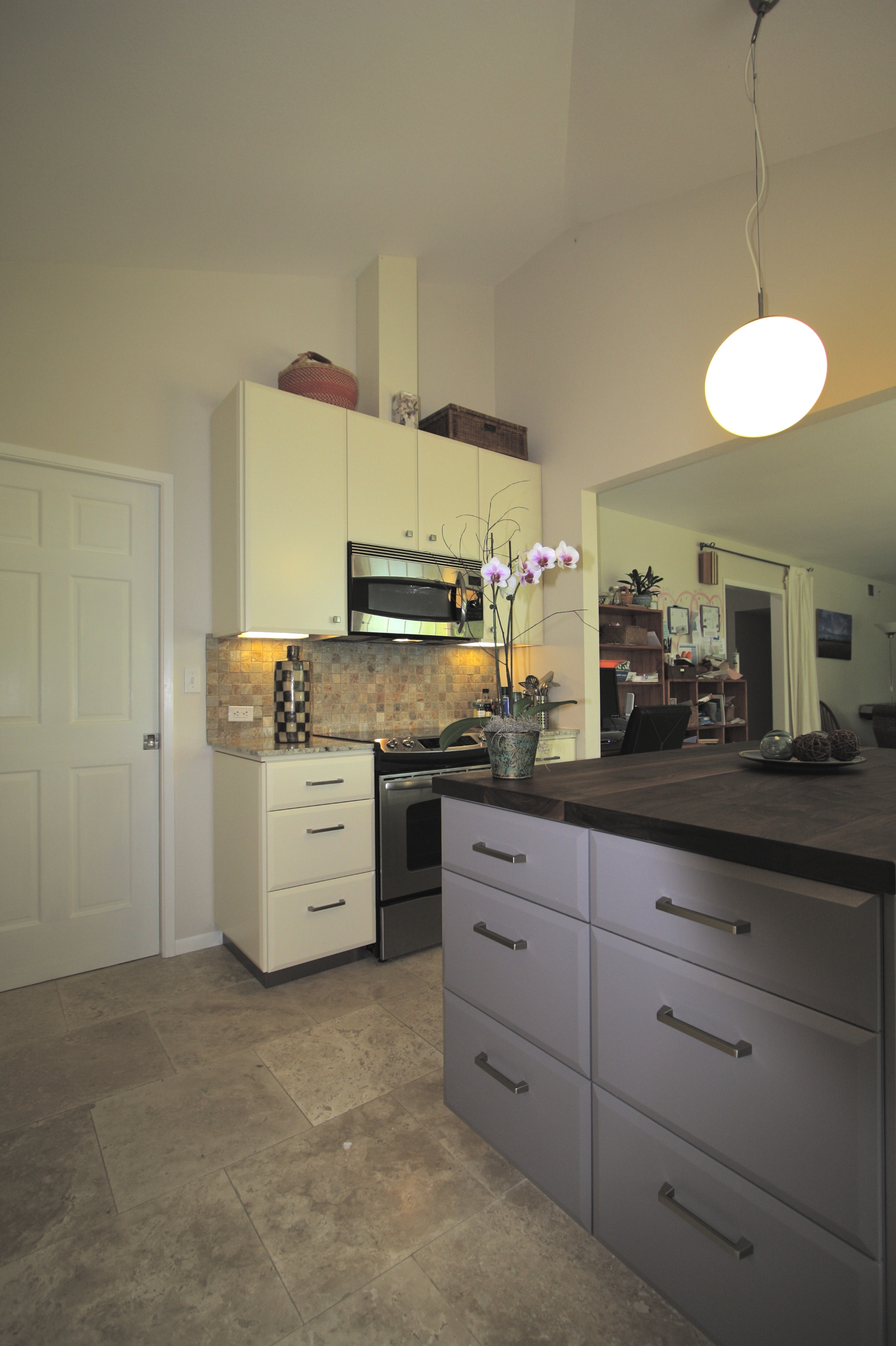After: Looking toward northwest corner.Kitchen design, material and colorconsulting on the project by Boatman Design.