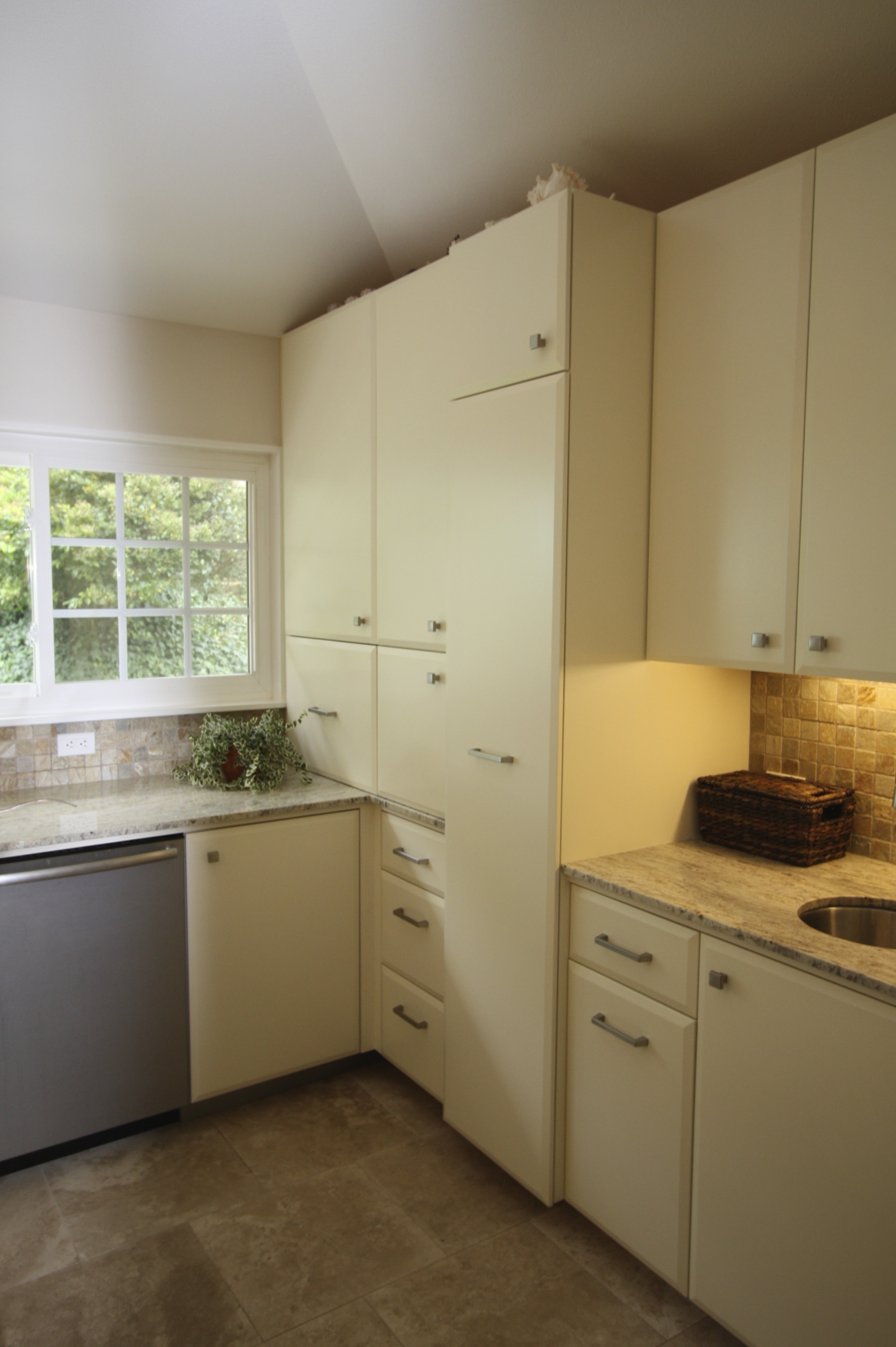 All cabinetry was custom built by Artistic Freedom Designs, a local green cabinet shop.All wood is FSC certified and is finished with water based lacquer.