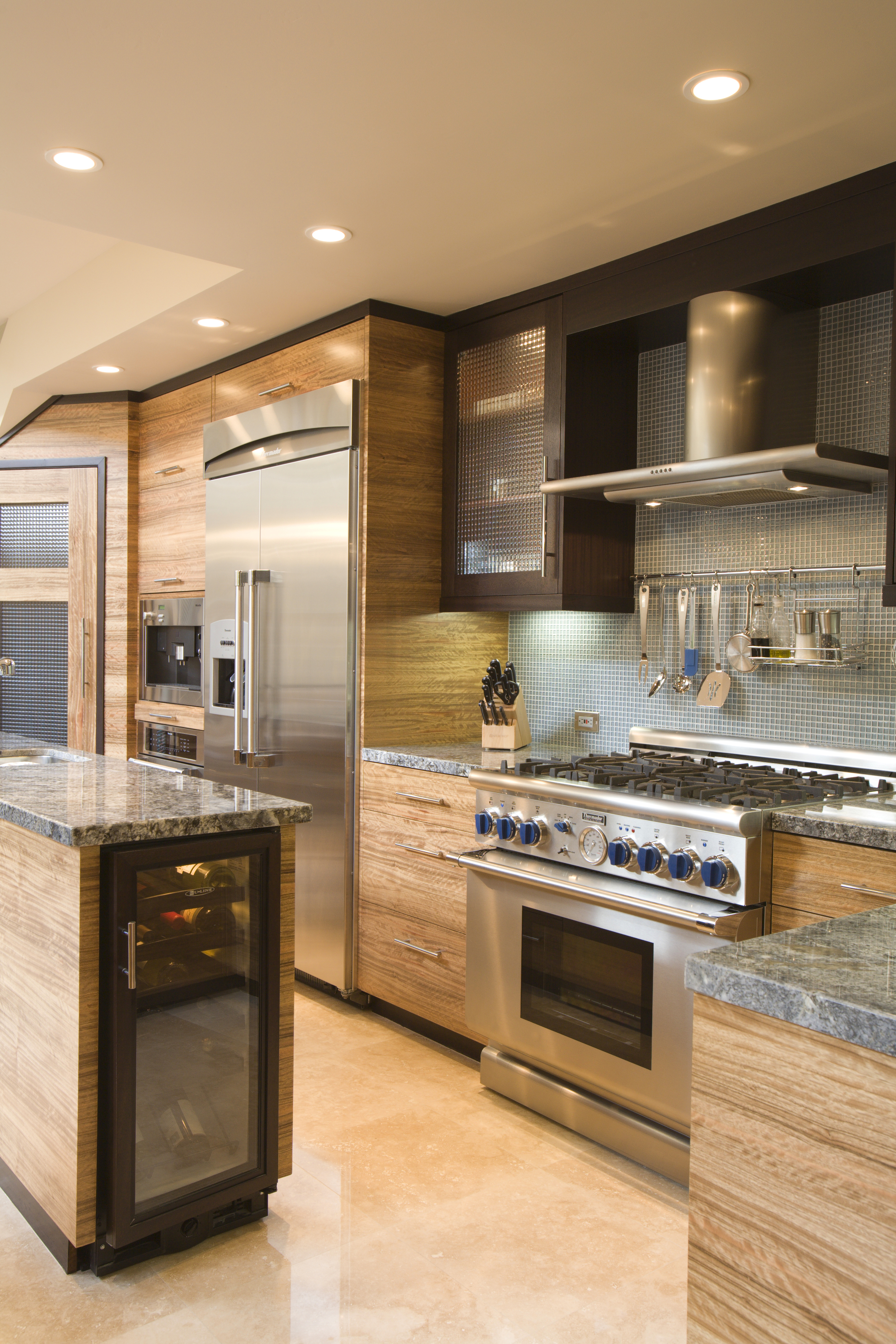 Kitchen features cabinetry of wenge and pal deo.
